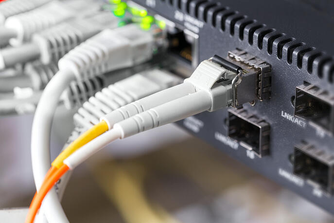 storyblocks-close-up-of-high-speed-fiber-network-switch-and-cables-in-datacenter_1500x1000